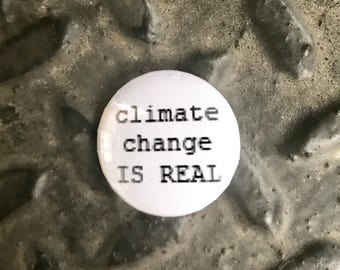 "climate change is real 1"" button"