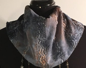 Scarf with a snap closure in the back