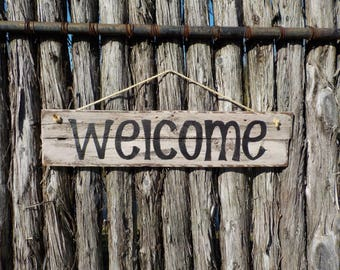 Hand made wooden welcome sign