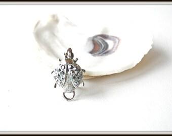 Vintage silver ladybug lapel pin or pendant with black rhinestones