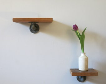 Shelf made from reclaimed wood and gas pipe fittings