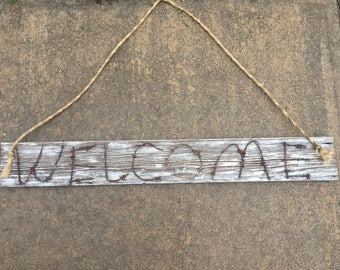 Welcome barbed wire sign