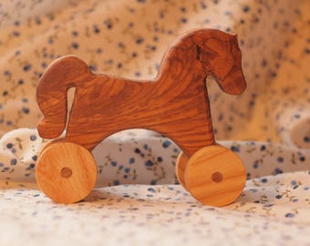 Wooden horse with wheels