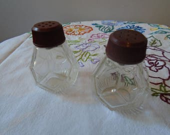 Salt and pepper shakers from the 50 - glass and bakelite