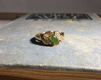 Vintage Gold-Tone Ring with Green Center Stone & CZ Accents