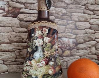 bottle of the decoupage . flowers .