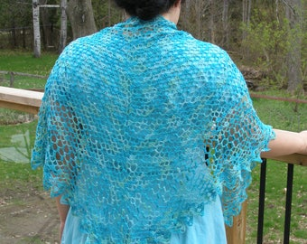 Lacy old-fashioned blue crocheted summer shawl