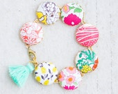 Flower Charm Bracelet, Gift for her, Liberty Of London Fabric Button Bracelet, Tassel Bracelet