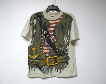 Pirata . light brown graphic tee shirt . medium