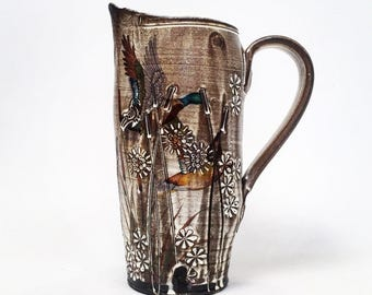Soda Fired pitcher with cattails