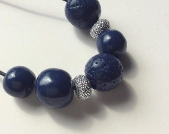 On Sale Long navy blue polymer clay beaded necklace with silver glittery beads. Black leather cord.