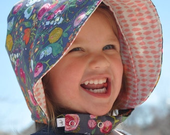 UB2 KYLE'S BLOOMS a rainbow floral bouquet and perfectly pink girlie goes-with-everything summer baby sun hat by Urban Baby Bonnets