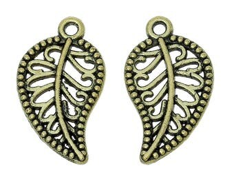 10 Curved Filigree Leaves Antique Bronze Leaf Charms 18mm x 11mm C169