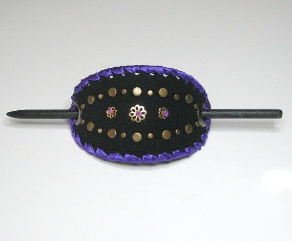 Stick barrette, hairslide, or bun holder. ART PIECE: Purple and black with metal studs.