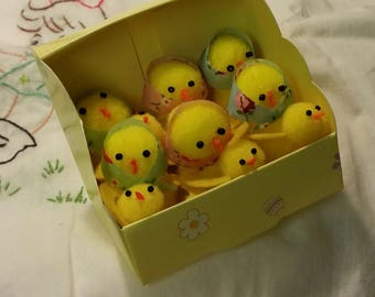 12 little yellow pom pom chicks