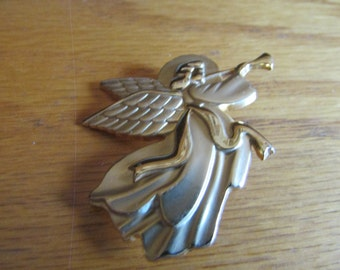 Angel with horn brooch