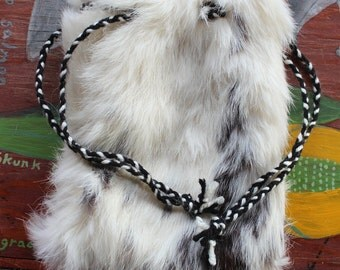 Vintage upcycled black and white rabbit fur drawstring pouch with braided yarn drawstrings dice tarot runes crystals