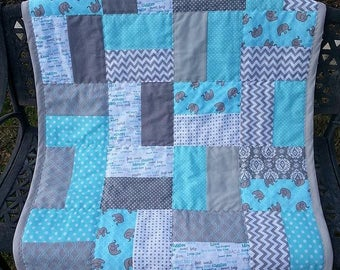 Tumbling Blocks Baby Quilt in Aqua, Grey and White with white flannel backing