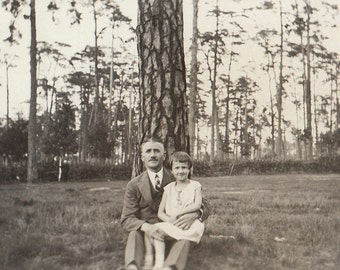 Original Vintage Photograph Snapshot Samall Sitting on Man's Lap by Tree 1920s