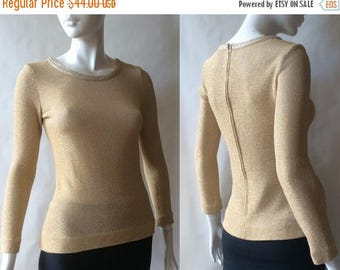 MOVING 4 GRADSCHOOL SALE 1960's slim fit gold sweater by Nancy Greer of New York, trimmed in gold gimp, with long sleeves, small / size 4