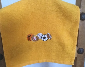 GOLD Sports Rally Towel with Machine Embroidered Basketball, Soccer ball, volleyball, football, baseball glove and baseball.