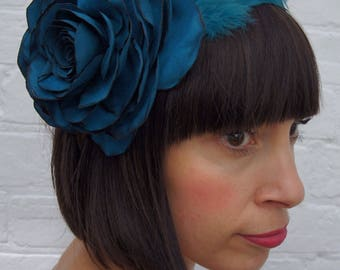 Turquoise suede look recycled rose flower headpiece with feather wing
