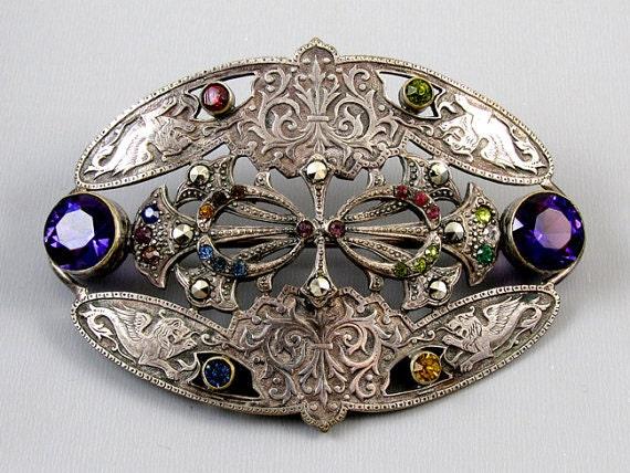 Exquisite antique Victorian silver on brass large sash pin brooch marcasite multicolored glass pastes winged griffin fleur de lis details