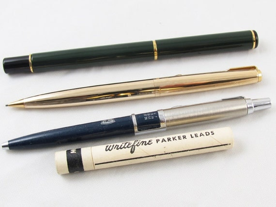 Vintage lot of 4 Parker pens and pencils / lead / Lawsons advertising calender pen / writing instruments / office / desk