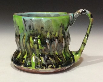Flaming green and black mug with chatter texture
