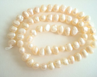 "Cream baroque flat sided pearls, 1 strand 16"" long, 8 mm cultured freshwater pearl beads, jewelry, embellishment, ornaments, costume design"