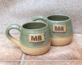 Pair of Mr and Mr cuddle mugs coffee tea cups in stoneware hand thrown ceramic pottery