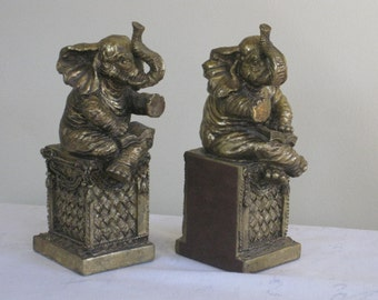 Pair of Vintage Whimsical Elephant Bookends, Heavy Gold Tone Elephants on Column / Pillar, Carved Figurine Statue Office Library Decor