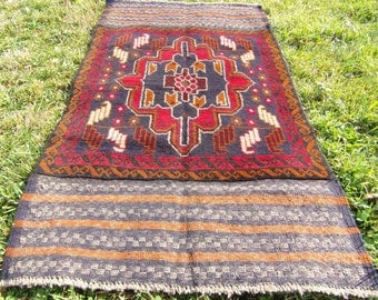 """Red/Brown Baluchi rug/kilim from Afghanistan. 4ft 6"""" x 2 ft 8. 140 x 85 cm Hand woven."""
