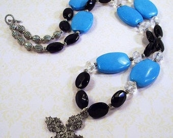 On Sale Large Blue Turquoise/  Black Faceted Beads and Crystal Necklace with Cross Pendant