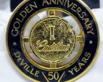 Cadillac Golden Anniversary Grill Emblem and Vintage Hubcap Cover
