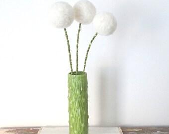 White pom pom flowers with vase.  Green wood grain vase.  Faux bois vase.  Felt flowers arrangement.  Table centerpiece.  Painted glass vase