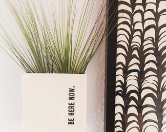 small porcelain planter / wall vase screenprinted text be here now.