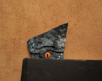 Grichels leather bookmark - scaly black and teal with poppy orange slit pupil reptile eye