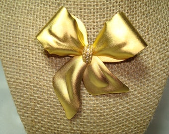Large Vintage Golden Bow with Rhinestone Center.