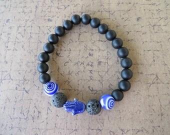 Essential Oil Diffusing Aromatherapy Stretch Bracelet With Cobalt Ceramic Hamsa Lava Stone And Onyx