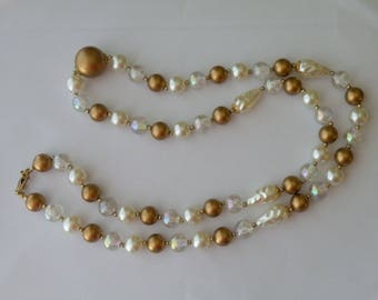 Plastic long necklace. Faux pearls, clear, gold beads.