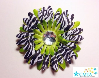 One green and zebra hair flower with a rhinestone. Portion of sale goes to charity.