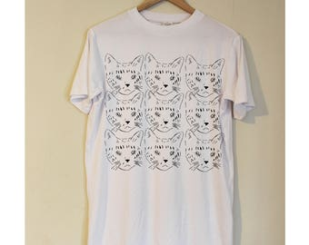 A soft White t shirt with Black cats print