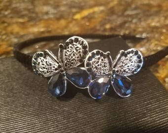 Headband with black velvet band and butterflies in deep blue
