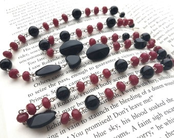 Ruby and onyx long necklace: Wealth Seeks Company; Kushiel's Dart, ruby necklace, sterling silver, red and black necklace, july birthstone