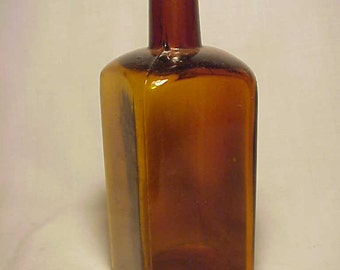 c1890s T. Metcalf Co. Boston, Mass.,  Cork Top Blown Glass Amber Medicine Bottle