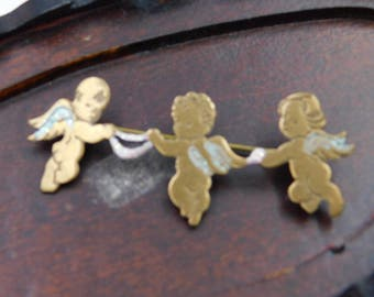 Vintage Pin or Brooch of some Cherubs or baby Angels with Painted Wings