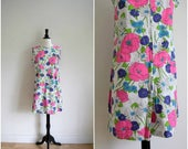 SALE Vintage mod floral romper / retro sleeveless jumper / pink, white, purple and green flowers skort dress / skirted romper