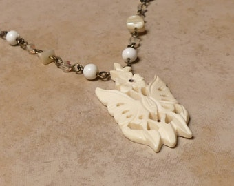 Vintage Carved Butterfly Pendant with Mother of Pearl ,Milk Glass and Aurora Borealis Glass Beads Chain