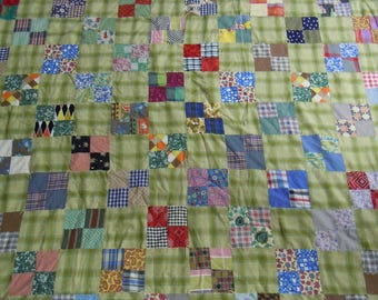 """Vintage quilt/comforter tied 1950's 4 patch cotton scrappy squares  alternate w green plaid blocks  floral fabric on the back 69"""" x 86"""""""